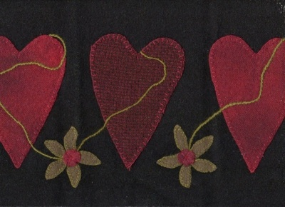 Red Wool Hearts on Black Wool Background