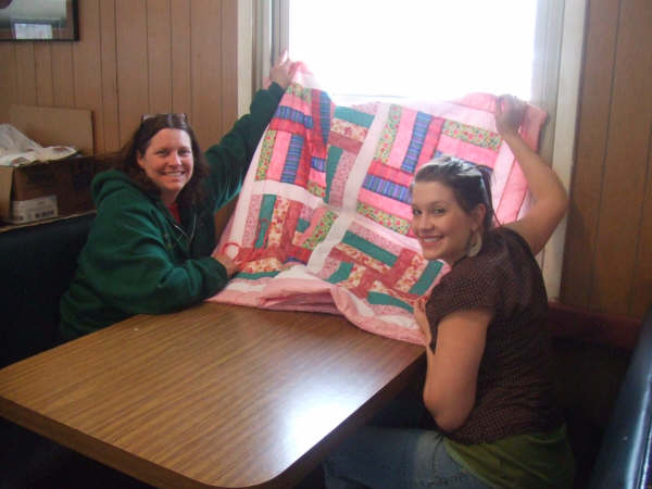 Cynthia taught her daughter to quilt! Genevieve's first quilt top!