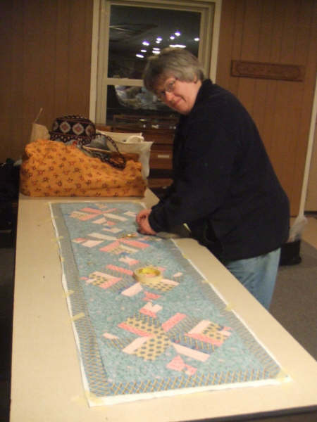 Newbie quilter Jeannette and her table runner